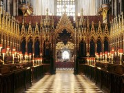 ATJN6T Westminster Abbey interior Choir stalls candle light gothic architecture London England UK nave Medieval architecture English