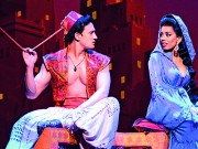 Disney Theatrical Productions under the direction of Thomas Schumacher presents Aladdin, music by Alan Menken, lyrics by Howard Ashman and Tim Rice, book and additional lyrics by Chad Beguelin at the Prince Edward Theatre London, starring: Dean John-Wilson (Aladdin), Trevor Dion Nicholas (Genie), Jade Ewen (Jasmine), Nathan Amzi (Babkak), Stephen Rahman-Hughes (Kassim), Rachid Sabitri (Omar), Don Gallagher (Jafar), Peter Howe (Iago) and Irvine Iqbal (Sultan) directed and choreographed by Casey Nicholaw