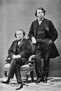 Intertwining lives: Clara became a muse to Johannes Brahms (seated) and was a regular duo partner of violinist Joseph Joachim