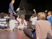 Piano Cleveland president Yaron Cleveland gives an outreach talk for school-aged children